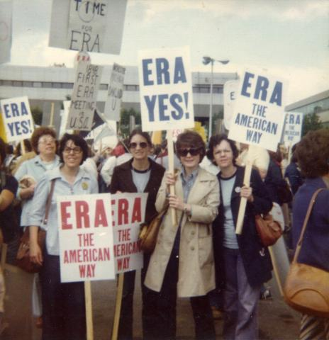 Photo of women holding signs as part of an Equal Rights Amendment demonstration