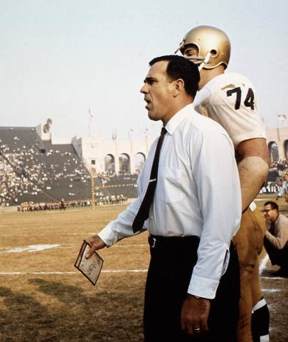 Coach Ara Parseghian on the sideline with a player